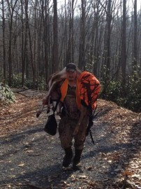 My cousin hikin out with his deer