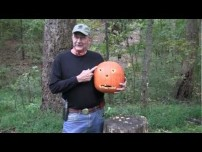 Pumpkin carving with a handgun.