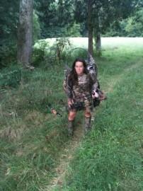 Big stand, little huntress.